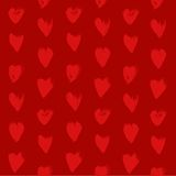 Seamless red pattern from red textured heart  shapes smears Royalty Free Stock Photo