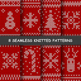 Seamless red and white knitted background. Set with eight seamless winter patterns. Red and white knitted background in scandinavian style with snowflakes, deer Royalty Free Stock Photo