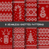 Seamless red and white knitted background. Set with eight seamless winter patterns. Red and white knitted background in scandinavian style with snowflakes, deer Vector Illustration
