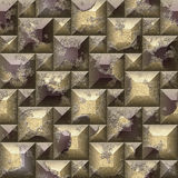 Seamless relief 3d mosaic pattern of scratched gold and brown beveled squares and pyramidal blocks Stock Images