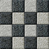 Seamless relief 3d pattern of black and white squares. Black and white embossed background resembling chessboard stock illustration