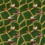Seamless relief pavement pattern of green polygonal stones and autumn fallen dry leaves Royalty Free Stock Images