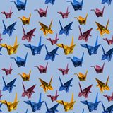 Seamless Repeat Origami Paper Cranes - photograph. Photographic repeat pattern consisting of 3 different colors of paper cranes of varying angles Royalty Free Illustration