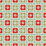 Seamless repeat pattern of stylized red flowers and green leaves in a geometric design. Vector background ideal for royalty free illustration