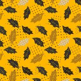 Seamless repeating pattern of autumn leaves and dots royalty free stock photography