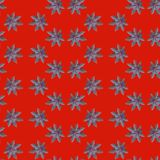 Seamless repeating pattern from ricinus communis on red background. Seamless repeating pattern from castor oil plant on red background, flower, wallpaper, floral stock photography