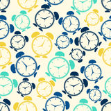 Seamless repeating pattern of colored abstract alarms.Vector Royalty Free Stock Image
