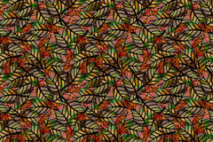 A seamless, repeating pattern of colored leaves Stock Photography