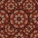 Seamless repeating pattern consisting of colored mandal. Royalty Free Stock Images