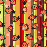 Seamless repeating pattern consisting of ladybirds and circles Stock Photos