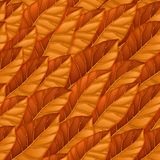 Seamless repeating pattern of orange autumn leaves. Autumnal vector texture. Vector texture for background, wallpaper stock photo