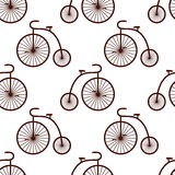 Seamless retro bicycle pattern. Vintage transport illustration. Royalty Free Stock Image