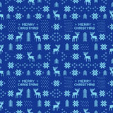 Seamless retro blue christmas pattern with deers, trees and snowflakes Royalty Free Stock Photo