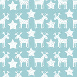 Seamless retro Christmas pattern - Xmas reindeer and night stars. Happy New Year background. Vector design for winter holidays on blue background Stock Photo