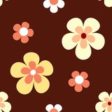 Seamless retro flower pattern. Retro flowers in bright yellow, orange and white on dark red brown background that will tile seamlessly. 7 global colours Royalty Free Stock Photography