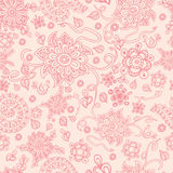 Seamless retro pink floral background, vector. Cute vector seamless pastel floral background. The  pink doodle flowers on the  beige background, great as a Royalty Free Stock Photo