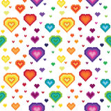 Seamless retro pixel game rainbow heart pattern Royalty Free Stock Images