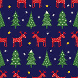 Seamless retro style Christmas pattern - varied Xmas trees, reindeer, stars and snowflakes. Stock Images