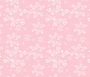 Seamless rose background with white snowflakes Stock Images