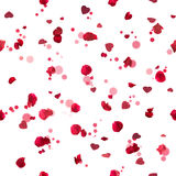 Seamless roses hearts. Repeatable, flying red, studio photographed rose petals in backl ight, with glittering hearts from different angles and bokeh particles Royalty Free Stock Photos