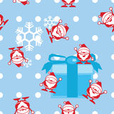 Seamless Santa claus with a gift background Royalty Free Stock Photography