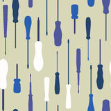 Seamless screwdrivers silhouettes background. Royalty Free Stock Photography