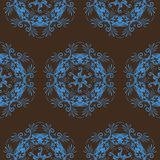 Seamless Scroll Design. Blue on brown seamless textile design of medallions, scrolls, spirals and flourishes Royalty Free Stock Photo