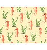 Seamless sea pattern. Orange seahorse and green algae on yellow Stock Photos