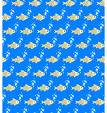 Seamless sea pattern. Yellow fish and light blue bubbles on blue Stock Photo