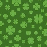 Seamless Shamrock background with light green blades of grass on green background. St Patrick day  Royalty Free Stock Images
