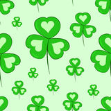 Seamless shamrocks with hearts Royalty Free Stock Photos