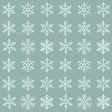 Seamless simple pattern of different blue geometric snowflakes. Seamless simple pattern of different  geometric snowflakes on blue background Royalty Free Stock Photography