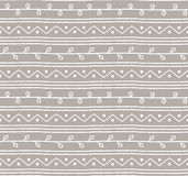 Seamless sketch vector pattern. Twigs lines and zigzags on grey background. Hand drawn abstract branch african style illustration Stock Photos