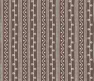Seamless sketch vector pattern. Vertical twigs lines and zigzags with circles on background. Hand drawn african style texture. Seamless sketch vector pattern Stock Image
