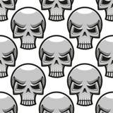 Seamless skulls pattern in cartoon style Stock Image