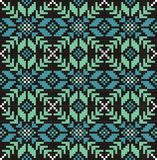 Seamless snowflake knitwear pattern, winter christmas background, card. Scheme for cross-stitch and crochet. Royalty Free Stock Images