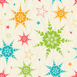 Seamless snowflake pattern. Seamless pattern with green, red and blue snowflakes over the beige pattern Stock Image