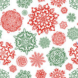 Seamless snowflake pattern in traditional christmas colors. Stock Photos