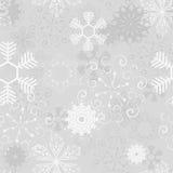 Seamless snowflakes. Beautiful seamless snowflake on a gray background Stock Photos