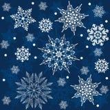 Seamless snowflakes background. Winter snowflakes on dark blue background. Vector seamless illustration vector illustration
