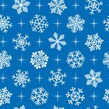 Seamless snowflakes background. Royalty Free Stock Images