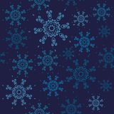 Seamless snowflakes pattern. Christmas design with blue snowflakes on dark navy background. Stock Image
