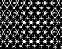 Seamless snowflakes pattern like a flower and leaf on background. Christmas seamless pattern from white snowflakes on black background Royalty Free Stock Photos