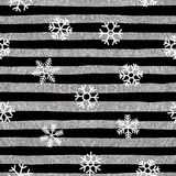 Seamless snowflakes pattern on striped background. Seamless pattern of falling white snowflakes on textured background of silver and black stripes. Elegant Royalty Free Stock Photography