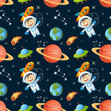 Seamless space pattern with astronaut, Earth, saturn, UFO, rockets and stars Royalty Free Stock Image
