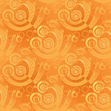 Seamless spiral pattern yellow orange overlaying shifty blurred Royalty Free Stock Photos