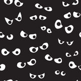 Seamless Spooky Eyes. A seamless pattern of a bunch of spooky eyes in the dark Stock Photography