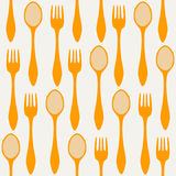 Seamless spoons and forks. Seamless orange spoons and forks Royalty Free Stock Photography