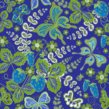 Seamless spring floral pattern with strawberries and flowers and butterflies (vector EPS 10). Stock Images