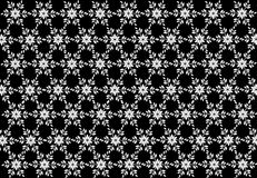 Seamless Star and leaf snowflakes pattern on background. Christmas seamless pattern from white snowflakes on black background Stock Photography
